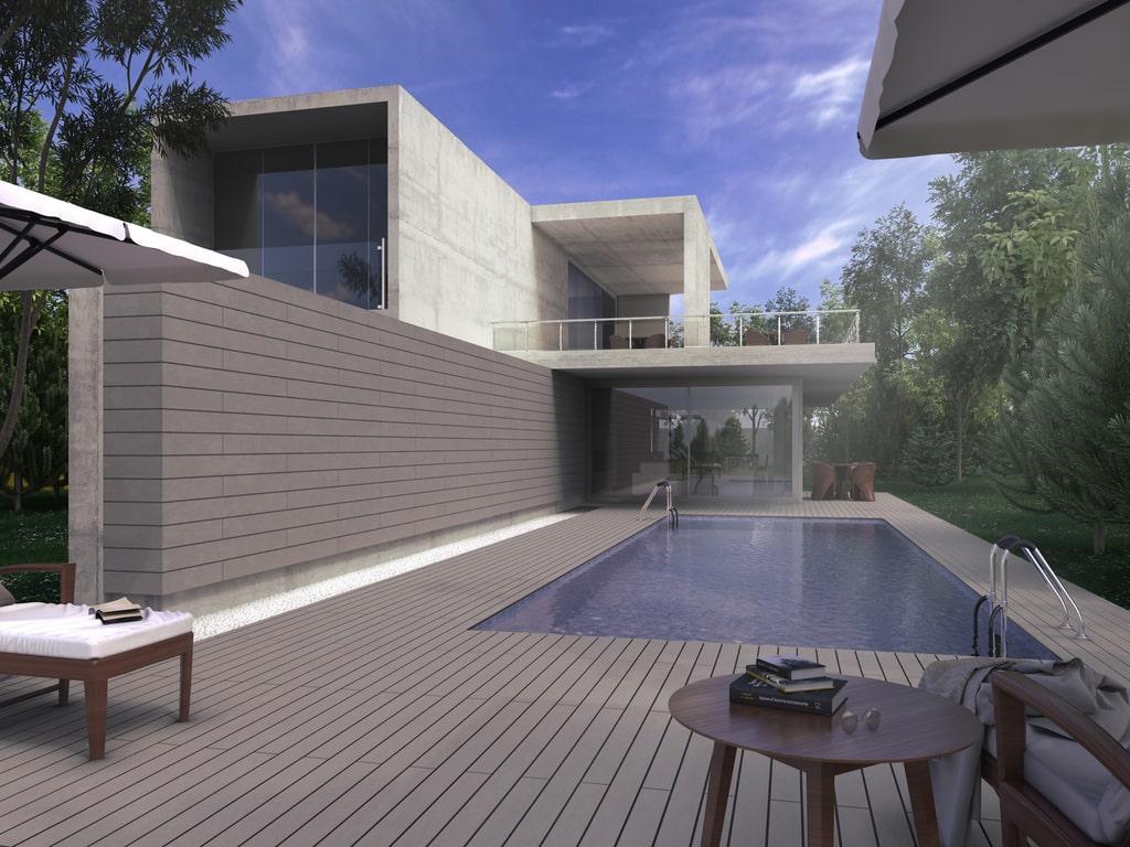 Casa con paredes exteriores revestidas con madera sintética